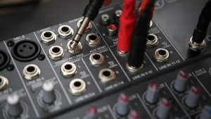 Plugging cables into a mixer board